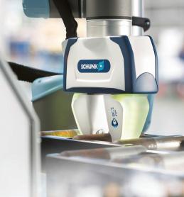 Při zakládání do obráběcího stroje umožňuje Co-act flexibilní souhru člověka a stroje