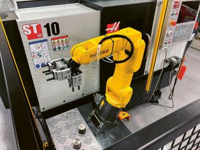 Obr. 5: Robotizace pracoviště Haas