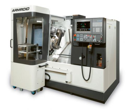 Obr. 2: Stroj vybavený robotem Armroid a pojezdným zásobníkem dílců